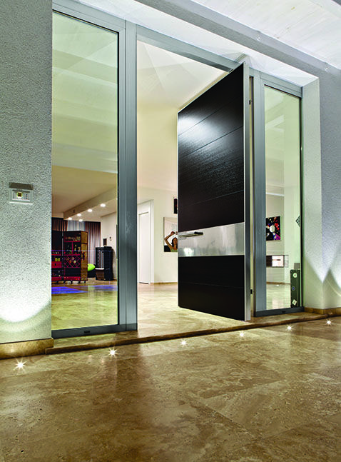Large pivoting doors by Oikos from Italy