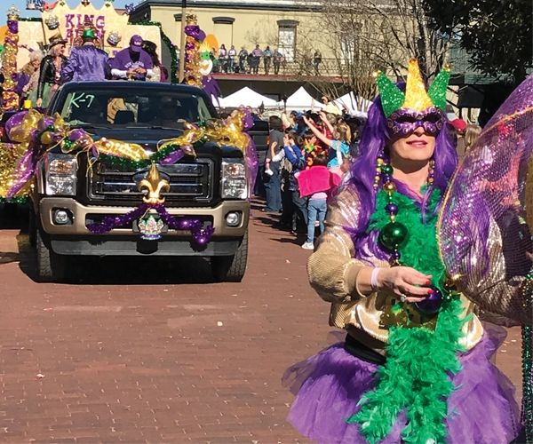Lots of dressed-up people drive and walk along the parade route at the 2016 Grand Krewe of Hebe Mardi Gras parade in Jefferson to entertain the crowds.