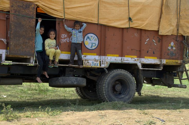 Three children and a truck, India 2013