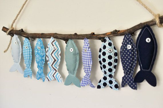 These darling fishies are looking for a home! This Blue Fish - Eco-Friendly Wall Decor is made from all natural materials, including ::    - all-cotton fabric (some reclaimed, some vintage, some new)  - bamboo fiber stuffing  - reclaimed vintage button eyes  - maple twig  - jute twine    **since no two twigs are alike, final product may look slightly different than what is shown in photo (fabric will be the same as shown in photos)    Each fish measures 6 inches long and is stitched with raw…