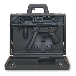 "The Heckler & Koch MP5K ""Koffer"" Special-Ops Edition.  Check the trigger in the handhold!"