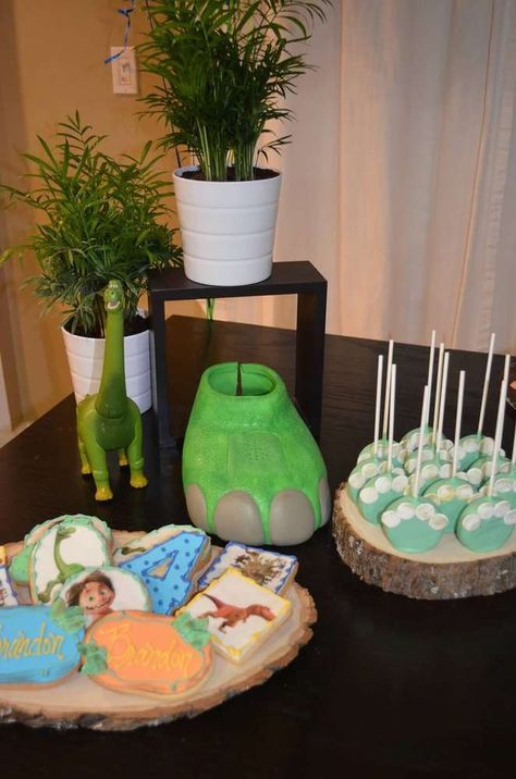 The Good Dinosaur birthday party cookies and cake pops! See more party planning ideas at CatchMyParty.com!