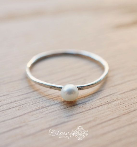 tiny pearl tiny pearl ring.  I love how delicate and simple it is. slim silver band. by lilpengee, $28.00