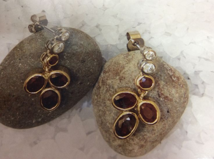 Ruby and diamond pebble design with seperatly articulated diamonds forming the cascade down to the rubys