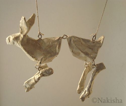 """Nakesha again  Bunny  Mixed media (wire, glue, twine, paper, tape, paint, glazes)  apx 6.5"""" x 2.5"""" x5""""  2008"""