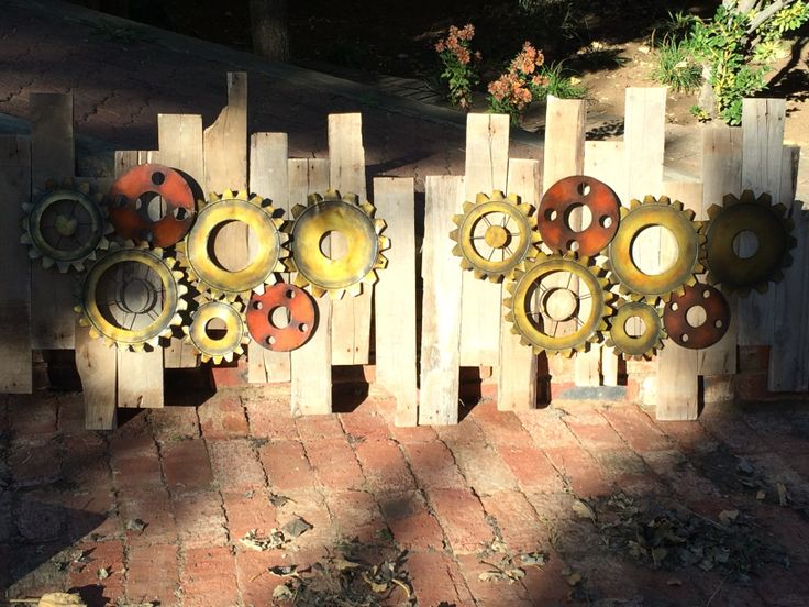 Gear and cog style clock mounts made for a customer using pallet slats.