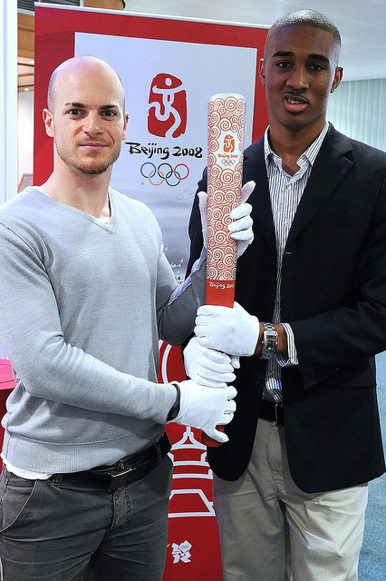 Brunel PhD student Nick Tiller (left) and graduate Ainsley Bell (right) holding the Beijing Olympic Torch at Brunel University Court in May 2012.  Nick and Ainsley were chosen as Olympic Torchbearers because of their achievements and charity work.  Brunel University Court 2012 by Brunel University, via Flickr