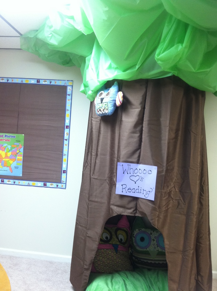 Reading Nook using two shower curtains on a hula hoop strung to the ceiling and table cloths pinned to the ceiling.