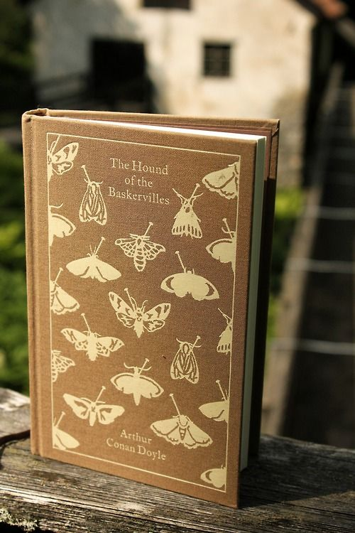 The Hound of The Baskervilles - Arthur Conan Doyle. Read in English. Oh, and I would LOVE to own exactly this edition; such a beautiful hardcover book :-D