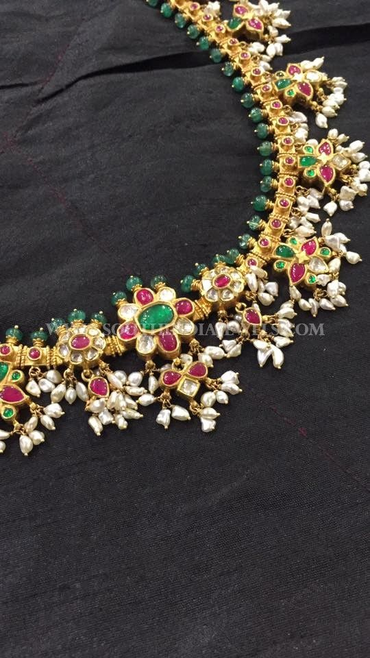 22K gold antique emerald guttapusalu necklace design. For inquiries please contact the seller below. Seller Name : Big Shop Website : http://www.bigshopooty.com/ Contact No: 04232444138 Email : bigshopooty@gmail.com Related PostsBeaded Necklace with Antique Pendant160 Grams Gold Neclace With Krishna PendantAntique Lakshmi Necklace SetGold Antique Temple Necklace From BhimaGold Plated Kundan Necklace Set with PriceGold Guttapusalu …