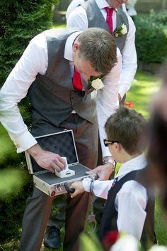 Wedding Photography - Ceremony - Page boy - Ring bearer - Security - Suitcase - Handcuffs - Grey suit - Red tie
