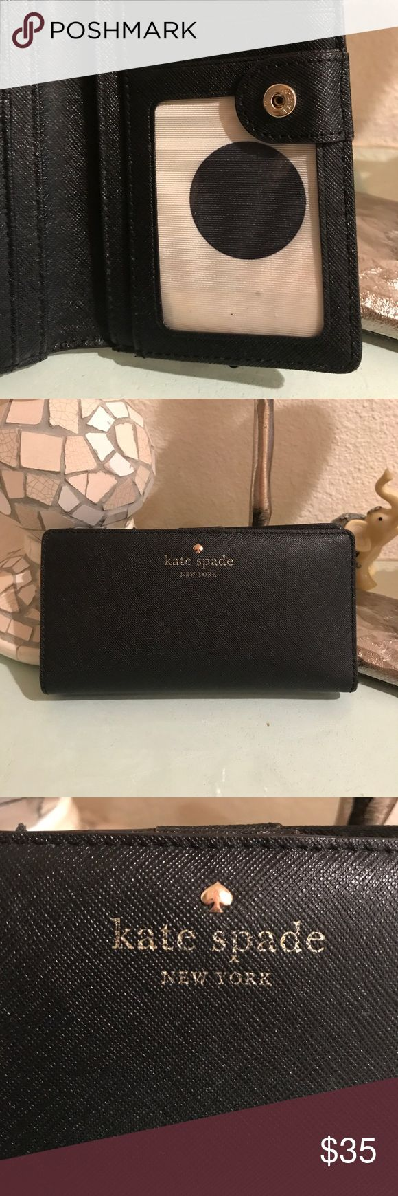 Kate Spade black saffiano leather wallet EUC Kate Spade saffiano leather wallet. Snaps closed, 14 card slots (one of them is transparent for ID's), 4 long inside pockets, zippered coin pocket on the outside, lining is the large black dots with cream background. Tiny dot stain on the inside ID card slot. The front Kate Spade logo is fading in the front and has slight wear on the hardware. Still a beautiful useful wallet. kate spade Bags
