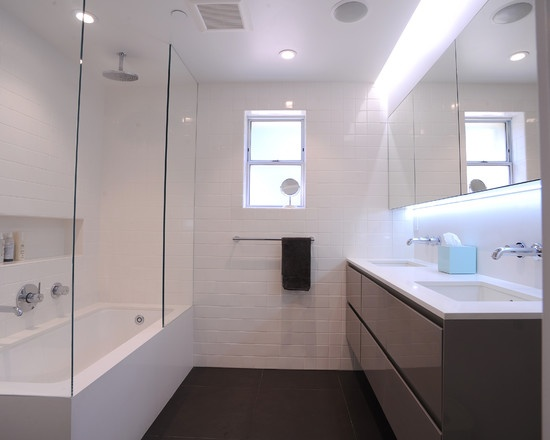 Pic On DMC San Francisco us Design Contemporary bathroom with Ceasarstone tub apron and recessed light valance over custom high gloss lacquer vanity