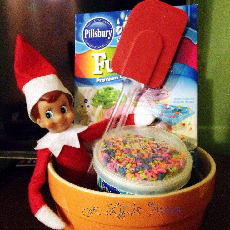 Elf on the Shelf: A Sweet Goodbye on Christmas Eve he lays out ingredients to make a birthday cake for Jesus.