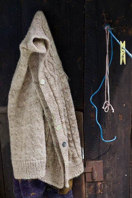 Grandma's sweater hanging on a nail in the barn. Another reminder of home in Romania.
