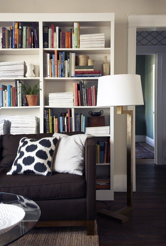 living room layout ideas place a bookcase behind your sofa. Black Bedroom Furniture Sets. Home Design Ideas