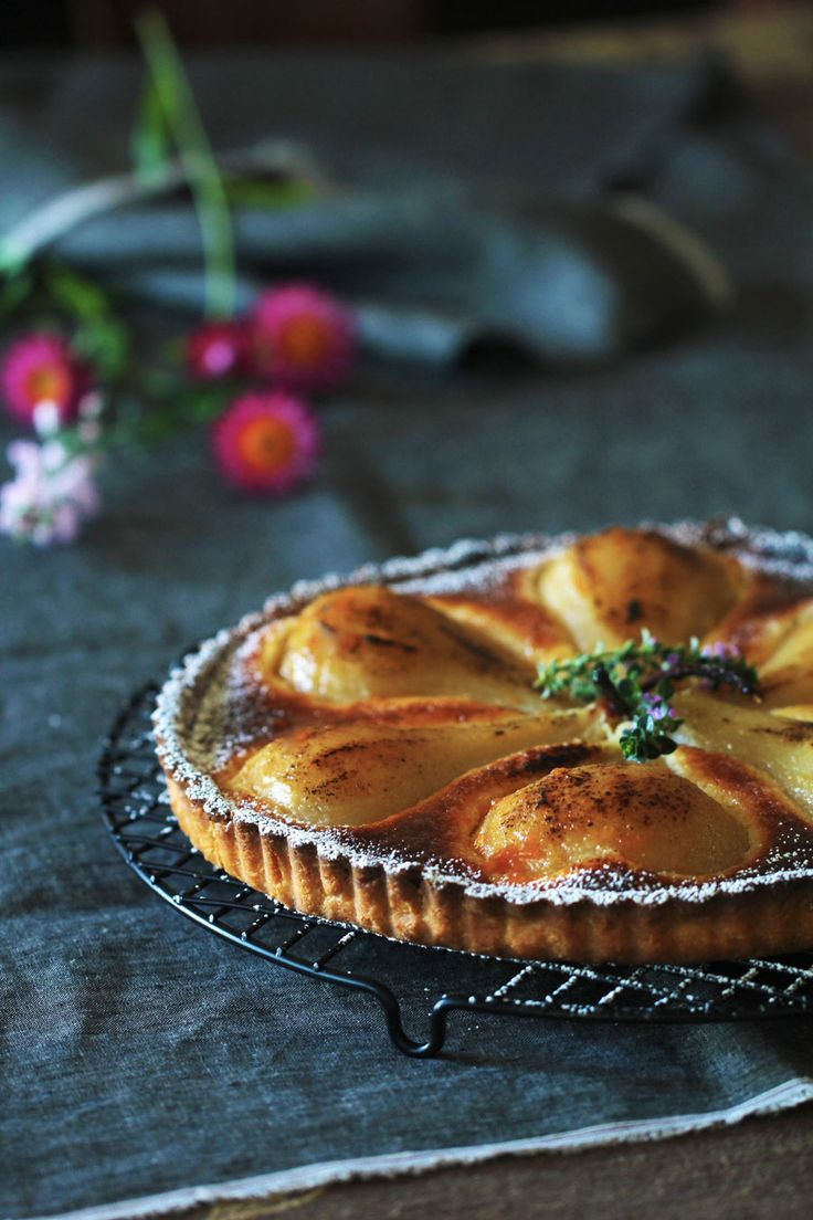 Poached pear tart with lemony cream filling