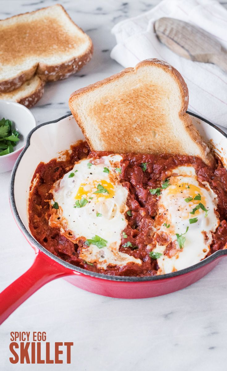Spicy Egg Skillet: Shakshuka is a breakfast skillet favorite that's made for sharing! Our spicy version pairs tomato sauce, garlic, onions and crushed red pepper with Parmesan, eggs and perfectly toasted slices of Arnold Country Buttermilk Bread to scoop up every ounce of flavor.