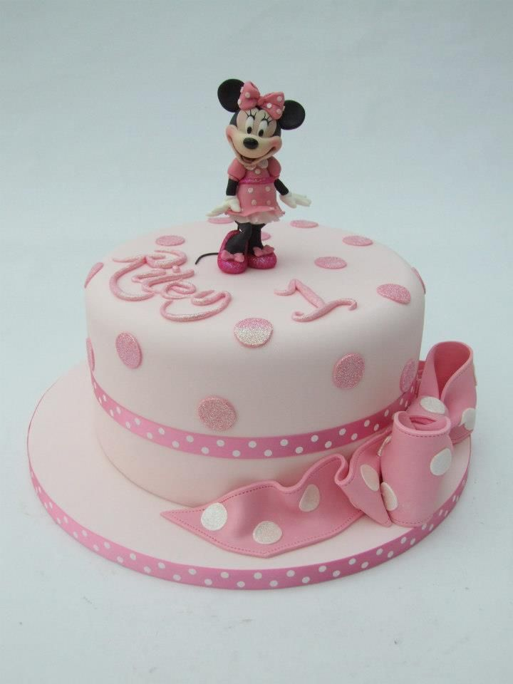 Minnie mouse first b-day cake. Classy with a touch of elegance. I love the shimmering pink dots and writing.  Great idea.
