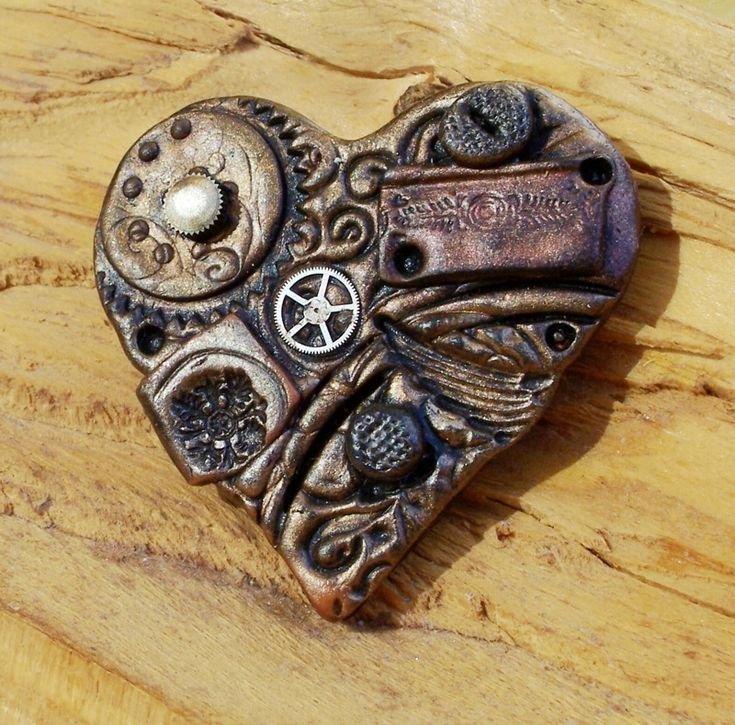 Steampunk brooch made with Fimo and watch parts. The artist who made this has done some awesome pieces.