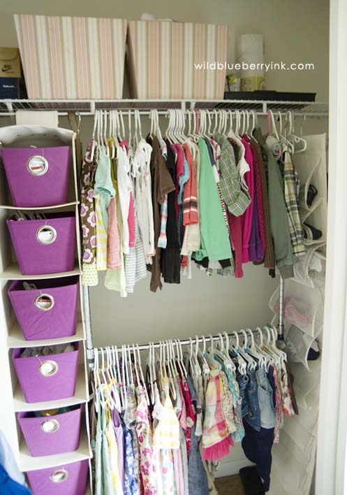 such a great idea to put bins in one of these sweater hanger things