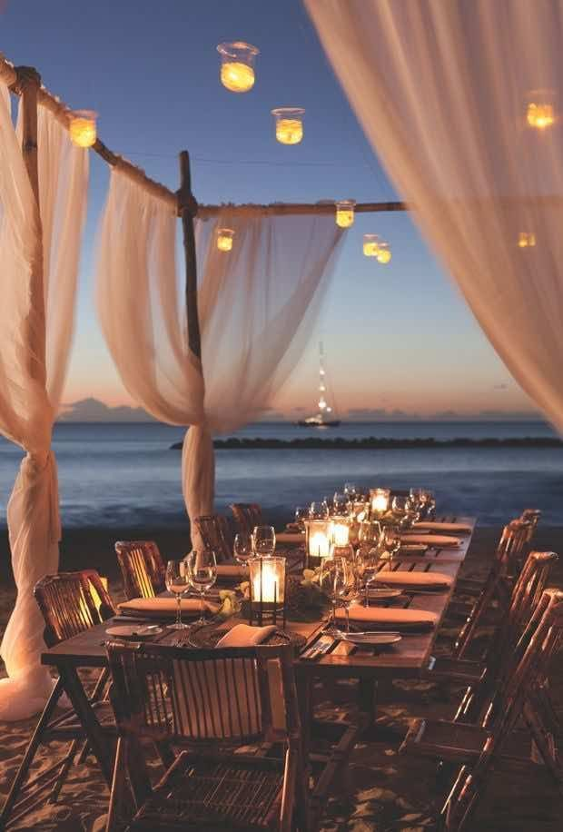 Reason to have a destination wedding: your reception venue can be the beach where the sunsets are stunning. Photo via Four Seasons Resorts via Venue Safari
