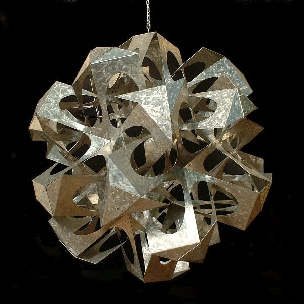 Mathematical Awareness via Geometric Sculpture. Whoville, aluminum, 35 inches. The form derives from an icosahedron and dodecahedron in mutually dual position, which would lie in the empty central region of the sculpture.     George W. Hart