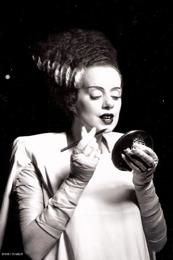 Elsa Lanchester fixing her makeup, for her role in The Bride Of Frankenstein