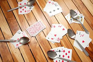 Spoons~~I played this one time in GA with my cousins and almost peed myself laughing b/c we had so much fun! I haven't played it since b/c I didn't remember how! ~ Gotta play this with the boys!