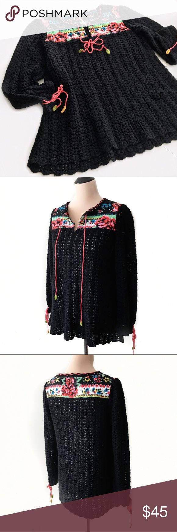 Free People Black Crochet Sweater Beautiful crochet and floral sweater by Free People. Cute granny sweater will look adorable with jeans and boots or a skirt and tights. In great condition. No tears, stains or pulls. Offers always welcome! Sorry no trades. Free People Sweaters