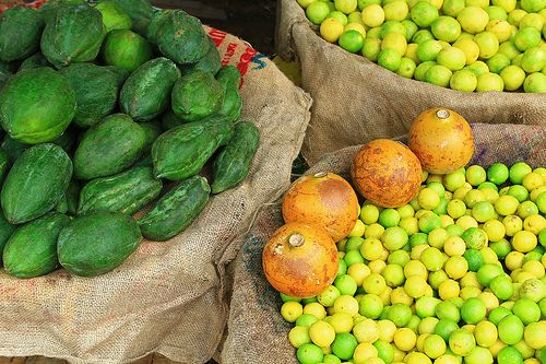 Papayas at a fruit market in Varanasi, India.  Papayas and lime make for a perfect fruit salad, the other fruit on the picture seems to be breadfruit but maybe an expert here on flickr can correct me if I am wrong :) Thanks a lot!