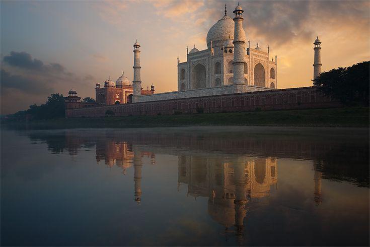 Photo of Taj Mahal at sunset reflected in River Yamuna