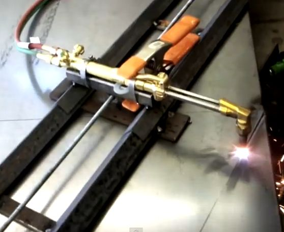 Cutting Torch Guide by Justin Edwards -- Homemade cutting torch guide constructed from angle iron. The torch assembly is connected to an electric motor by means of a threaded rod, thereby automating the cutting process. http://www.homemadetools.net/homemade-cutting-torch-guide-2
