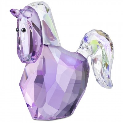 This beautiful horse gallops elegantly around the ring, leaving the air filled with a cloud of crystal dust.