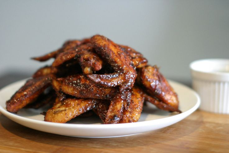 Perfect for Friday night dinner, or late night snacks while watching the All Blacks take out another world cup, or just because – these wings are quick, super easy and delicious. Cooking them in the oven like this makes them soak up any sauce they touch – ensuring an even coating and giving the skin an amazing texture. It's also a fairly healthy way of emulating that deep-fried effect and colour, without all the oil!