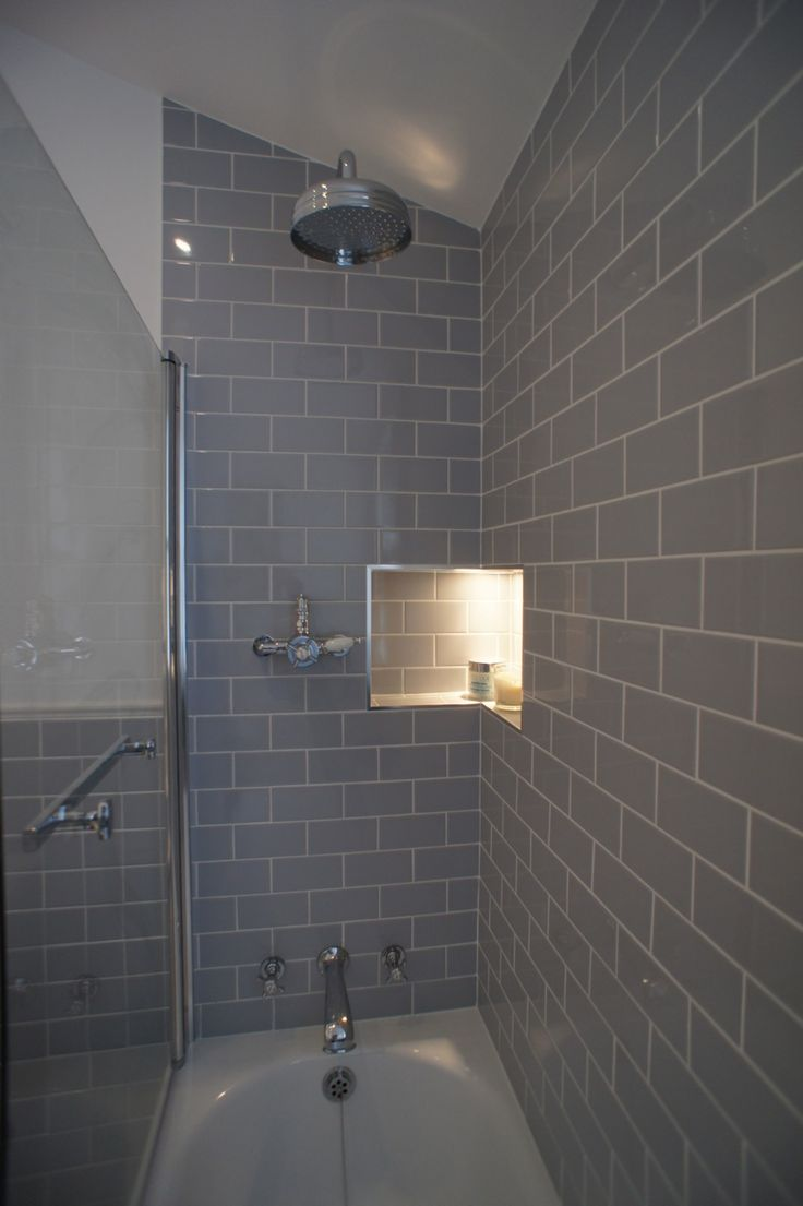 These photos were sent in from an interior designer who created this beautiful bathroom using our grey flat retro metro i like the lighted corner for the