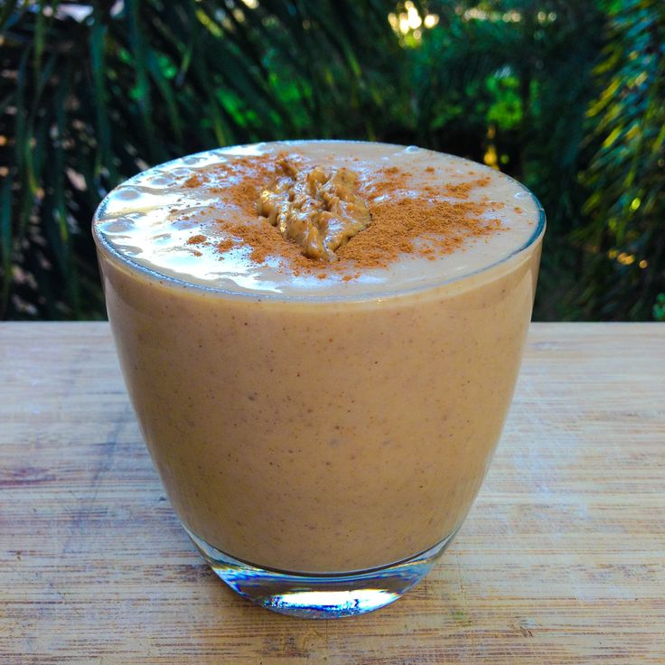 Apple Pie Smoothie made from pureed apple, coconut water, almond butter, vanilla, cinnamon, nutmeg, all spice, maple syrup and ice.