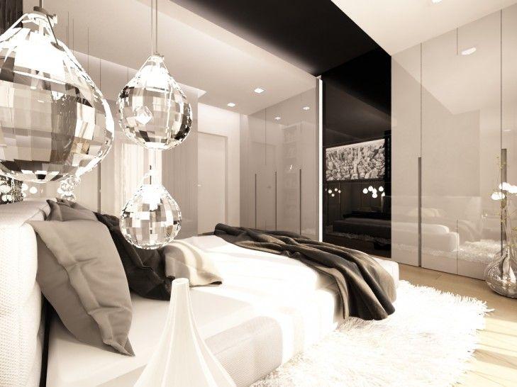 Aranżacja wnętrza eleganckiej sypialni w rezydencji pod miastem. Przez całą długość pomieszczenia przebiega czarny pas z ornamentem 3d za łóżkiem.