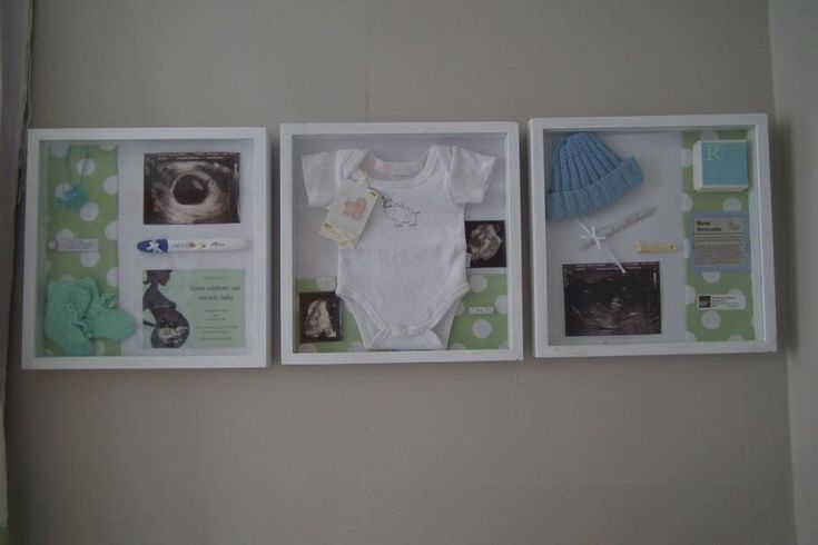 Why keep babies trinkets in a box for no one to see? This is super easy -Hot glue gun,babies trinkets, shadow box frame & a bit of creativity. On the left : necklace from baby shower game,hospital tag,7week ultrasound pic ,booties,pregnancy test & baby shower invite.  Middle: First body suit,3D ultrasound pic's,sticker from baby shower.  Right: hospital hat,pregnancy test, 12 week ultrasound pic,umbilical clamp,Birth announcement, lid off Baby shower favor box