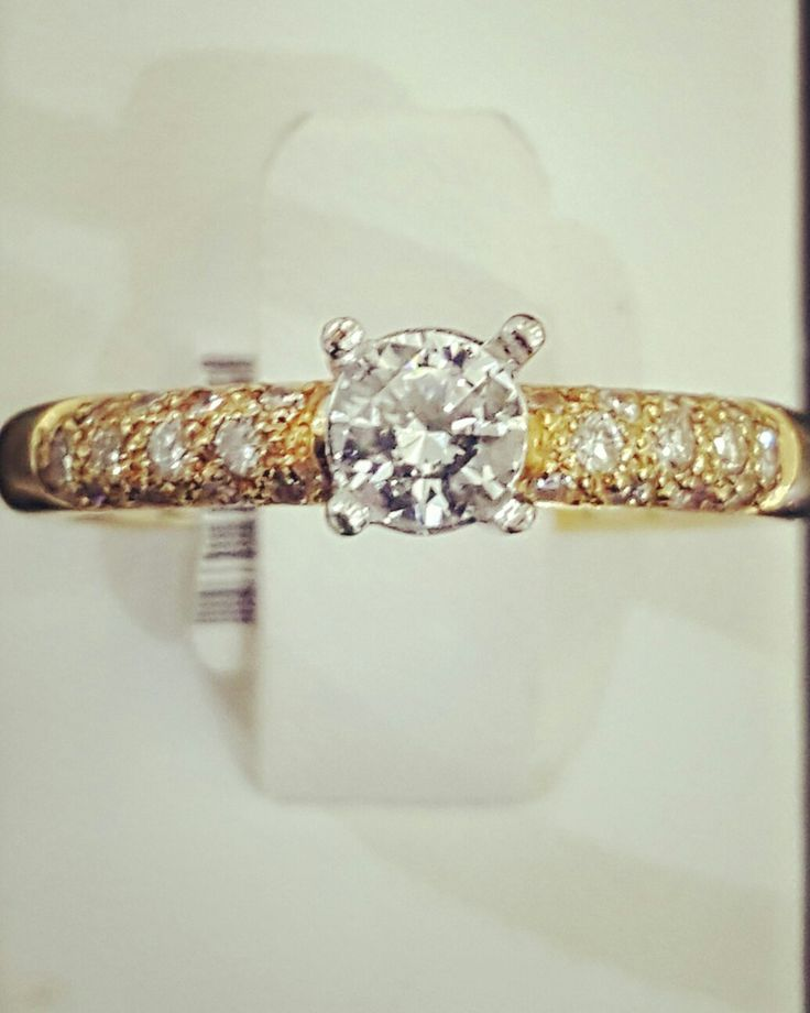 Engagement Ring 18ct gold with pave set shoulder stones and a. 60ct Diamond.  Customise your own ring to suit your budget :)