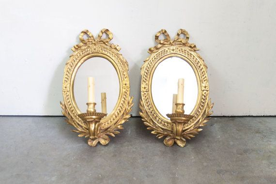 Pair of French Style Oval Gilt Wall Sconces with Mirrors