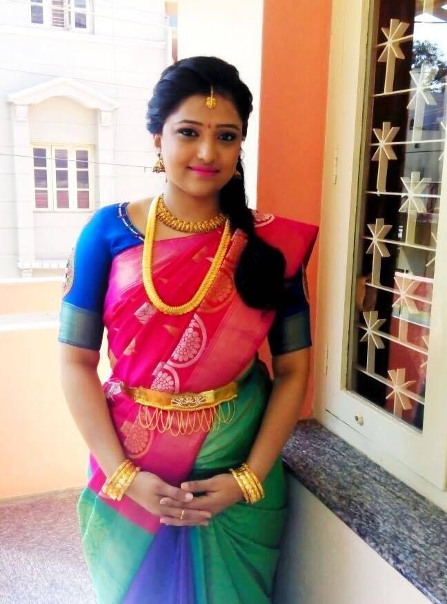 Traditional Southern Indian bride wearing bridal hair, saree and jewellery. Engagement look. Makeup by Swank Studio. #BridalSareeBlouse #SariBlouseDesign   Find us at https://www.facebook.com/SwankStudioBangalore