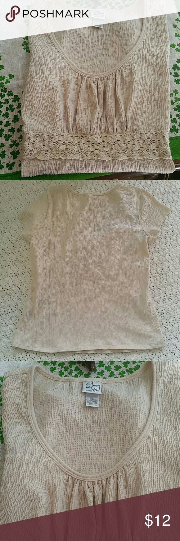 Ladies Short Sleeve Top Very pretty light beige short sleeve top. Soft material with lace detail in the front, top has a puckered look to it. Size is XL,  length is 24 inches, armpit to armpit is 18 inches,  EUC no flaws  Smoke Free Home Tops