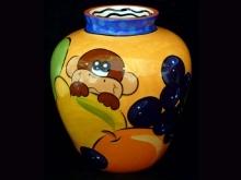 Peek-a-boo #PEFI pottery with trademark monkey amidst fruits. http://galerianamu.com/shop/folk-arts/ceramic/tropical-vase $139