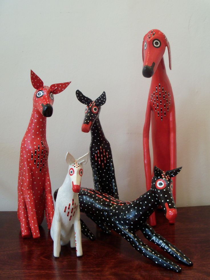 Wooden sculptures by Alphus. Using acrylic paint. At Artisan Gallery 031 312 4364. info@artisan.co.za