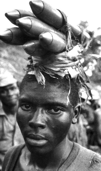 Carrying rockets in Biafra,1968~ Photo by Gilles Caron ♛