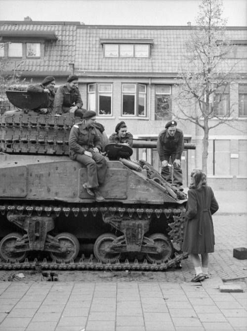 A Dutch girl converses with the crew of a Sherman tank of the South Alberta Regiment in Bergen op Zoom Netherlands - 29 October 1944