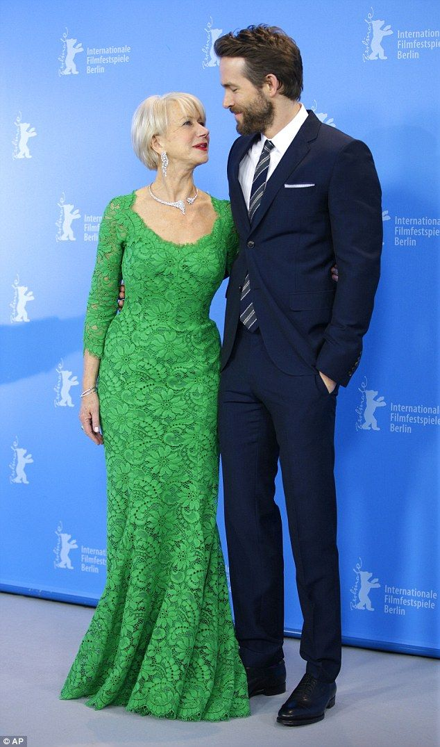 Green goddess: Dame Helen Mirren cosies up to her co-star Ryan Reynolds as they attend the...