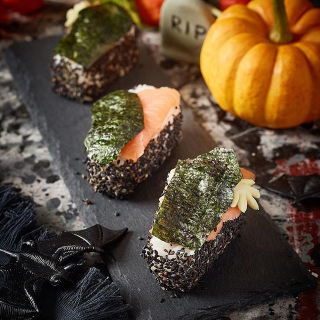 Spooky Sushi⚰ Easy, tasty, and fun! Perfect for any Halloween parties! . Ingredients for 6 coffins: - 125g Yutaka Sushi rice - 1 1/2 tbs Yutaka Rice vinegar - 1 tbs sugar - 1/2 tsp salt - Yutaka black sesame seeds - Yutaka Nori sheets - Tube of Yutaka wasabi paste - Smoked salmon . You can make a small hand out of a piece of parsnip or sugar icing! . #Yutaka #YutakaRecipes #halloween #spooky #sushi #happyhalloween #recipe #cooking #japanesefood #healthyeating #healtyfood #foodart #tric...
