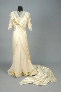 TRAINED SILK WEDDING GOWN with LACE and ORANGE BLOSSOM TRIM, 1920s.